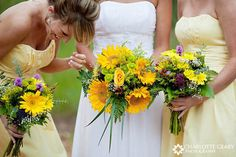 Bride and bridesmaids with yellow bouquets