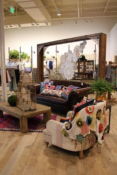 this is from an anthropologie store, but the idea is so great--neutral pieces, bright colors #home #decor #livingroom