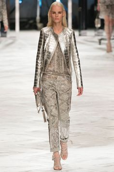 Read Emily Holt's review of Roberto Cavalli Spring 2014 collection.