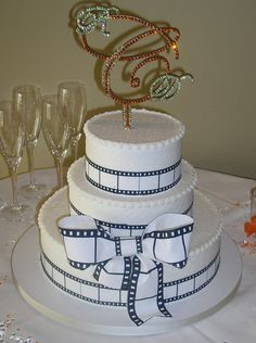 Movie lovers delight. . . this film strip wedding cake has just a touch of whimsy. Cakes by Graham     More Than Just Icing On The Cake