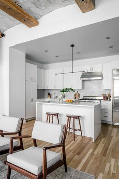 Designer, Michelle Zacks, created kitchen cabinetry that was all refinished in white to allow the sunlight to reflect better throughout the space.