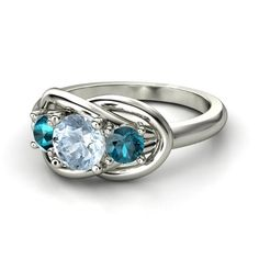 Right hand ring: aquamarine and London blue topaz set in sterling silver