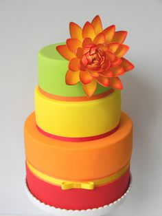 Tropical water lily cake in neons - by Just Call Me Martha. Perfect for summer or destination wedding.