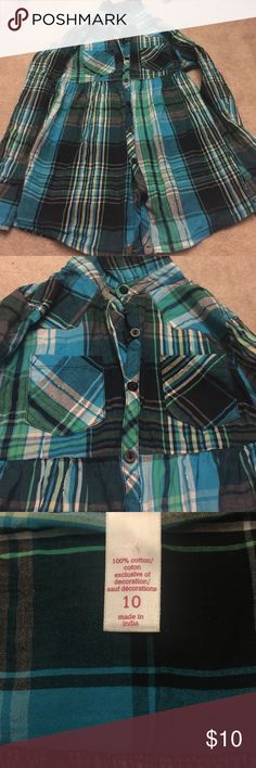 Teal button down shirt Justice size 10 button down plaid shirt. Shirt has a few different blue colors, black, white and silver throughout. Ties in the back. Justice Shirts & Tops Tees - Long Sleeve