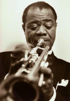 Louis Armstrong [1901, New Orleans, LA - 1971, Corona, New York City, NY] nicknamed Satchmo or Pops, was an American jazz trumpeter, singer, and one of the pivotal and most influential figures in jazz music.