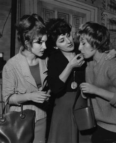 C.1960s Irene is apparently pulling a hair out of Shirley's mouth (i hate that) while tina looks on(that's the official story)