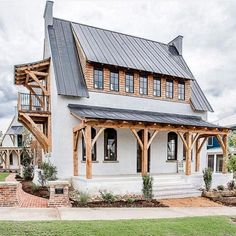 """This home named """"The Edison"""" has a unique style and design that I love!🖤The exterior wood accents against the white brick and black metal… Café Exterior, Dream House Exterior, Exterior Design, Bungalow Exterior, Brick Design, Modern Farmhouse Exterior, Farmhouse Design, Farmhouse Style, Farmhouse Decor"""