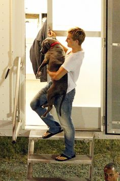 Puppy love: Josh Hutcherson was seen lifting his pet pooch Driver down the steps of his trailer on the set of The Hunger Games: Catching Fire in Atlanta Georgia yesterday. I think I love him. Hunger Games Cast, Hunger Games Catching Fire, Hunger Games Trilogy, Josh Hutcherson, Llamas, Tom Felton, Jenifer Lawrence, Liam Hemsworth, Mockingjay