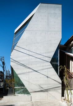 Made from volcanic ash: On the streets of central Tokyo, the architects at Atelier Tekuto have created an exposed-concrete residence.