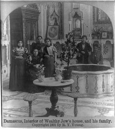 Interior of wealthy Jew's house, and his family The Jewish community of Damascus dated back to the Days of the Second Temple in Jerusalem. Over the centuries, their numbers were supplemented by Jews who were expelled from Spain in In the cour Antique Photos, Old Photos, Mizrahi Jews, Syrian Jews, Israel, Temple In Jerusalem, Jewish History, This Is Us Quotes, North Africa