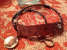 I designed and hand made this Copper bracelet, it is stamped on the copper piece with the tree of life and attached is a moon with stars.  The stones are all natural and the clasp is brass. The bracel