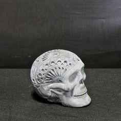 Día de Muertos skull in concrete