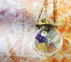 10% SALE Necklace Birds and Flowers Natural Gravel Glass Bead Orb Easter. £25.64, via Etsy.