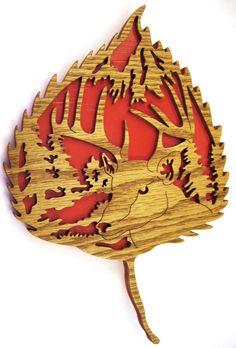Buck deer head in a red leaf scroll saw cut.