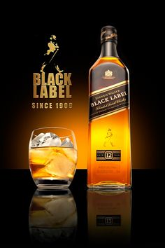 Johnnie Walker Black is one of the most well known scotch whiskeys. That being said, we made the color of the whisky the focal point for this image. Whiskey Or Whisky, Whiskey Brands, Scotch Whiskey, Whiskey Bottle, Booze Drink, Alcoholic Drinks, Tequila, Alcohol Dispenser, Alcohol Bottles