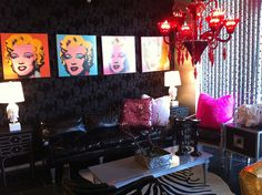 Pink and Black Diva Glam Living Room - zebra hide rug, red chandelier, & fun black & white decor