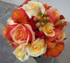 "Bridesmaid bouquet of ""mango"" calla lilies, creme de la creme  and cherry brandy roses with hypericum berries"