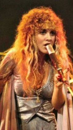 beautiful Stevie onstage  ~ ☆♥❤♥☆ ~   wearing a skimpy silver outfit and a peach-coloured shawl, her hair all fiery from the stage lights