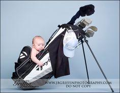 newborn baby in golf bag