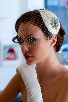 Vintage style Bridal Headdress and birdcage veil in pleated silk.