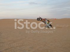 iStock - BUY ME! - Dune Buggy Popping a Wheelie in Glamis royalty-free stock photo