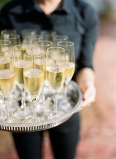 Champagne was waiting for guests as they arrived at cocktail hour. | Over The Moon #OTMWeddings