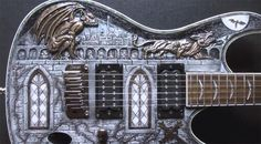 This one almost makes me want to play the guitar!  http://www.guitarnoize.com/custom-carved-gargoyle-ibanez-sa-guitar/