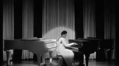 "Black & White are Beautiful - Hazel Scott on 2 Grand Pianos -  from a 1943 movie called ""The Heat is On"" staring Mae West"