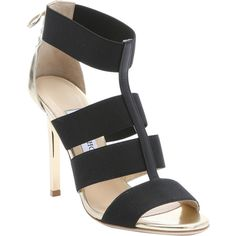 Jimmy Choo Black And Gold Elastic Strappy 'dario' Lace-Up Detail... ($633) ❤ liked on Polyvore featuring shoes, sandals, black and gold sandals, elastic-strap sandals, open toe sandals, jimmy choo sandals and leather lace up sandals