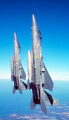 A pair of McDonnell Douglas F-15C Eagles from the 27th FS go vertical.