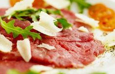 Carpaccio is an Italian recipe for a raw beef appetizer traditionally dressed with a lemony mayonnaise. This recipe uses balsamic vinaigrette instead. Finger Food Appetizers, Appetizer Dips, Finger Foods, Carpaccio Recipe, Baby Arugula, Potato Heads, Charcuterie, Vinaigrette, Italian Recipes