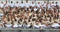 University of Central Florida football players and coaches clown around during a photo shoot at Bright House Stadium, on the team's 'media day' at UCF Thursday, August 1, 2013 . (Joe Burbank/Orlando Sentinel)