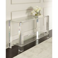 Interlude Home Landis Acrylic Console Table (11,995 SAR) ❤ liked on Polyvore featuring home, furniture, tables, accent tables, acrylic, handmade tables, handcrafted furniture, hand made furniture, handcrafted tables and acrylic console table