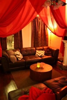 Decadent, lush red fabric moulin rouge party livingroom!