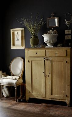 Image above: I spend a lot of time sifting through flea markets and antique stores. These pieces were treasures I picked up from various places. I love how a black wall completely transforms a place. I used chalkboard paint to get this look. It makes every piece in the room stand out. paige morse