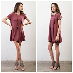 🆕Cute Swing Dress Color can be best described as a rust/reddish-burgundy. Loose fit/flowy. One of my daughters faves!! 93% Rayon, 7% Spandex. This is more of a juniors fit. Made in the USA. April Spirit Dresses Midi