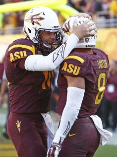 Arizona State quarterback Taylor Kelly hugs D.J. Foster