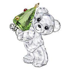 Swarovski teddy bear holding a Christmas tree crystal figurine