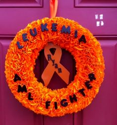 I made this wreath for a very special person's front door. There is no awareness for AML( Acute Myeloid Leukemia) Her son has been in and out of the hospital for the last 8 months. He is 5 years old and named Ryan and he is my Hero.