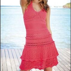 VICTORIA'S SECRET PINK CROCHET HALTER DRESS Beautiful crochet dress. Very comfortable and in great condition. Worn once at the beach. Also it's not super short. Victoria's Secret Dresses Midi