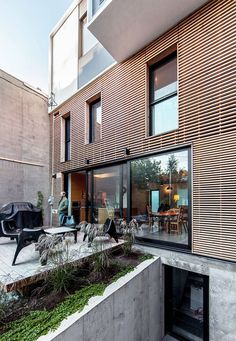 Extending a home with limited space is a tricky affair, and even though most home additions expand into the backyard, this duplex in Montreal's Little Cladding Materials, Street Pictures, Small Terrace, Timber Cladding, Duplex House, Little Italy, Architect House, House Extensions, Facades