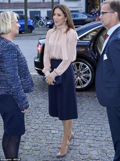 Despite her packed agenda, the princess was all smiles as she arrived at the conference, which centred around responsible management and value creation in companies