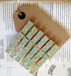 Notice that the tape doesn't cover the metal part - 6 full size wooden clothes pegs, floral washi tape