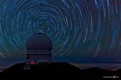 This is a picture that was taken during approximately 1.5 hours on Mauna Kea, Big Island, Hawaii. In the foreground, you can see the Canada France Hawaii Telescope. On Mauna Kea, nights are amazingly clear and dark. Mauna Kea Star Trails by Andreas Koebert.