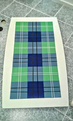 Oliphant Tartan hand painted onto a tiled top table.