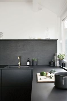 Purely utilitarian surfaces, like concrete kitchen countertops. The material is eco-friendly and affordable, and when painted or sealed in a sleek color, like the matte charcoal counters featured in this kitchen, the look feels fresh yet approachable. Black Kitchens, Home Kitchens, Kitchen Black, Narrow Kitchen, Charcoal Kitchen, Cottage Kitchens, Modern Kitchens, Kitchen Remodel Before And After, Interior Minimalista