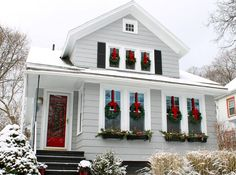 Holiday House- Wreaths with ribbon on all windows.