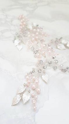 This beautiful handmade bridal hair piece made with shiny silver crystals, silver tiny leaves and blush glass pearls. Complement most wedding hairstyles. It is the perfect bridal headpiece for that woman who wants to simply sparkle on her wedding day. ♥ Size approx 23 сm (9) ♥ Flexible and