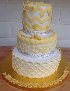 50th wedding anniversary cake. The marvellous molds onlays were used on each layer. The scallop one at the bottom was excellent.