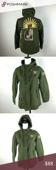 Amazing Cat Green Military Army Utility Jacket I love this jacket so much!!! It is a lightweight army jacket with stars on the front and an amazing cat on the back! Super soft cotton.   Label says XS but fits like a small. Zip up with snap buttons at top and bottom. Two large hip pockets with buttons.   This brand is sold at Anthropologie. 4 Our Dreamers Jackets & Coats